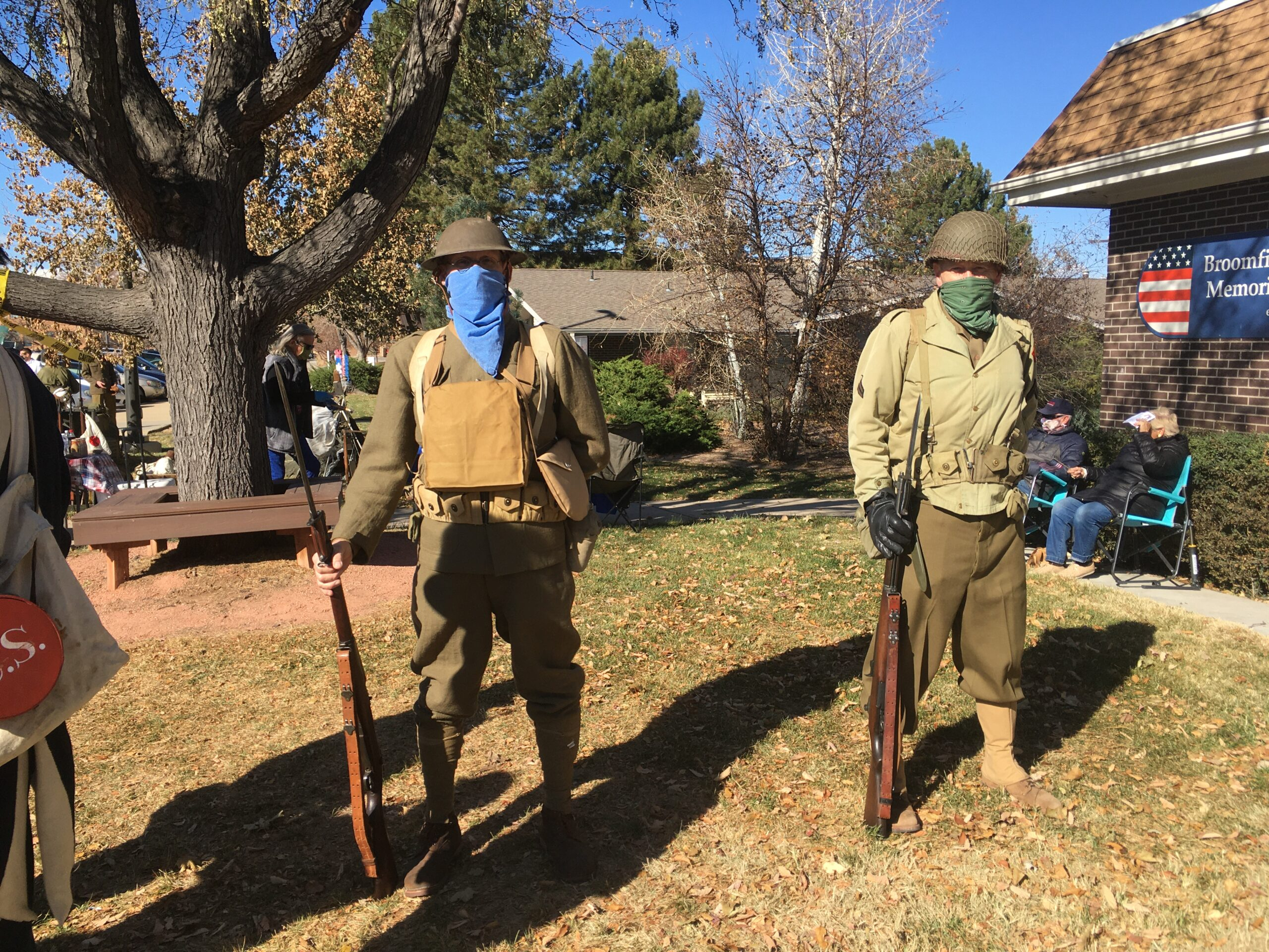 Veteran's Day 2020 Ceremony at the Broomfield Veterans Museum. Two WWI Reenactors stand ready at museum entrance.