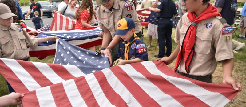 Local boy scouts help cut up and retire flags at the Flag Retirement Ceremony.